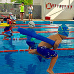 How to develop healthy competitive spirit with your kids, and how to teach them to enjoy swimming?